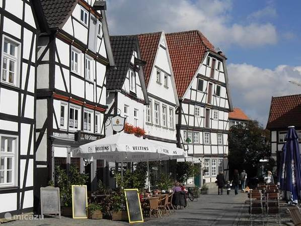 Relax on the terrace, after shopping between the traditional half-timbered houses.