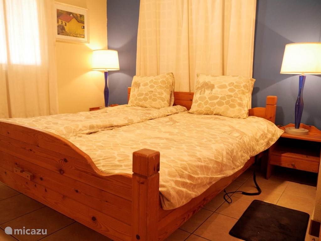 The bedroom. In the bedroom is a flat. You can also receive 1-2-3 Netherlands.