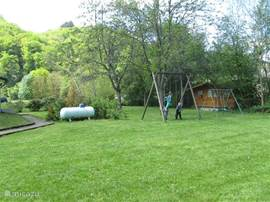 Large garden with swing and barbecue
