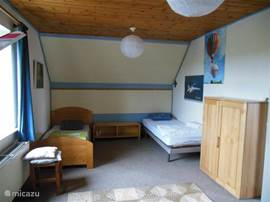 large bedroom for 4 people with nice soft beds, wardrobes, bed linen included.