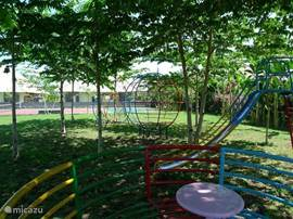 the playground with slide, carousel rocking chair and climbing frame