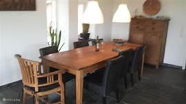 8-seater dining table in transition between living room and kitchen