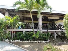 New rentals on secured resort's Villa Chili Pepper. This beautiful tropical house with large porch, is a high level with great views in a cool breeze. The house is surrounded by a beautiful palm garden with blooming bougainvillea and has 2 parking spaces.