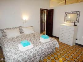 The master bedroom is attractively furnished. You will find built-in wardrobes, air conditioning and ceiling fan.