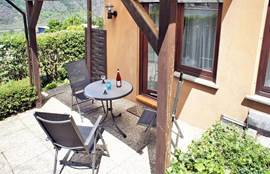 The secluded private terrace is sunny and has a garden furniture.
