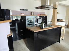 The open kitchen with all modern equipment available.