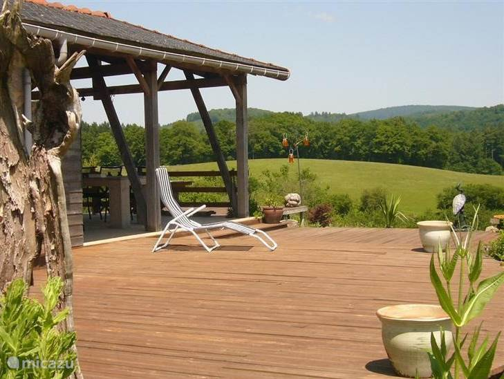 Sun terrace on south side with relaxing loungers; Here from early morning until early evening sunbathe.