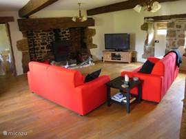 2 generous 2.5-sofas in the lounge overlooking the immense fireplace and the TV - LED (127 cm), the fireplace is equipped with a wood stove.