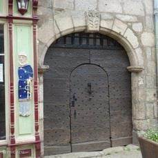 Old door of house in medieval town center Saint-Léonard-de-Noblat