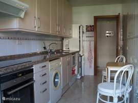 The kitchen has all required facilities. There is an extendable dining table for two persons.