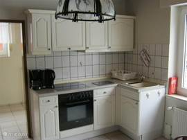 You can use a well-equipped kitchen (ceramic) stove with oven, refrigerator and coffeemaker.