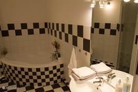 ...met de bijbehorende badkamer