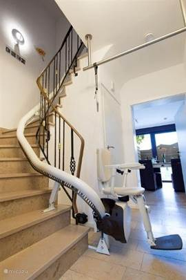 staircase with stair chairs