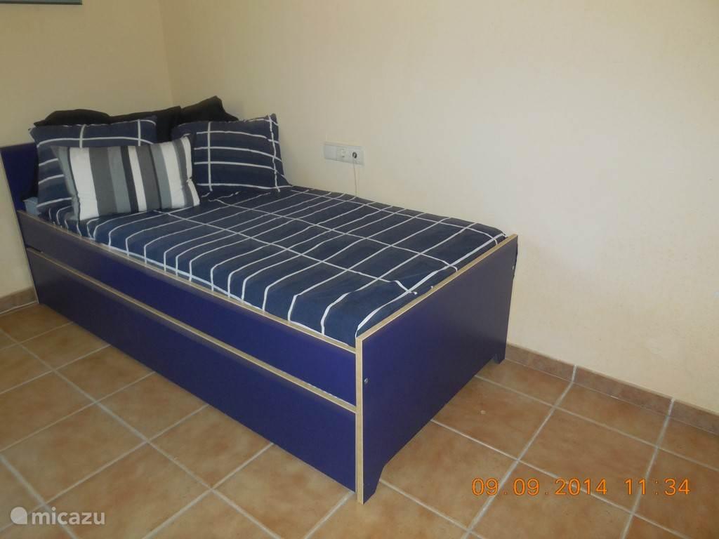 slaapkamer met onderschuifbed