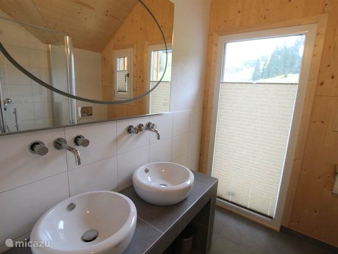 Upstairs bathroom with double sink design. From the bathroom, overlooking the mountain.
