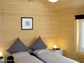 Slaapkamer 1 per vakantiewoning: 2 - pers. comfort boxspring bed