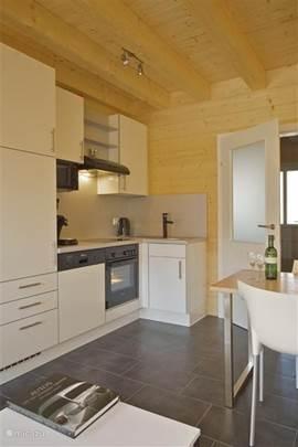 Keuken per vakantiewoning:  Modern en zeer compleet ingericht.