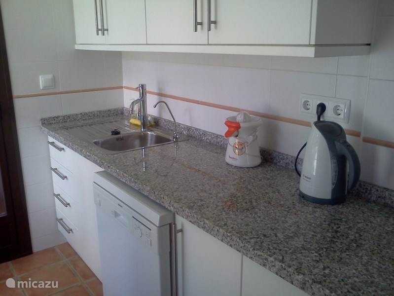 The kitchen is fully equipped. There is even a tap with purified water. So no lugging water bottles from the supermarket.