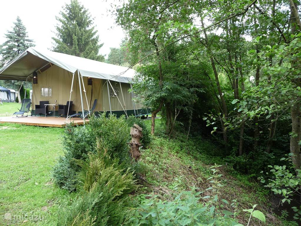 The Glamping tent is beautifully situated by the river.