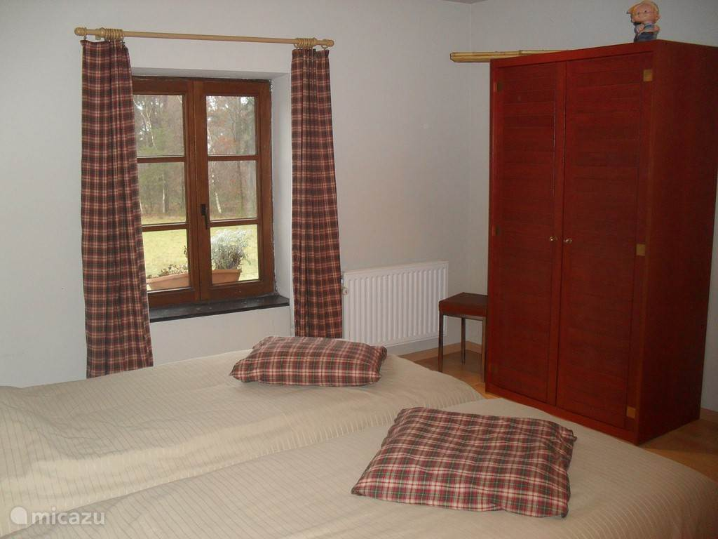 Kamer met 2 1-persoonsbedden
