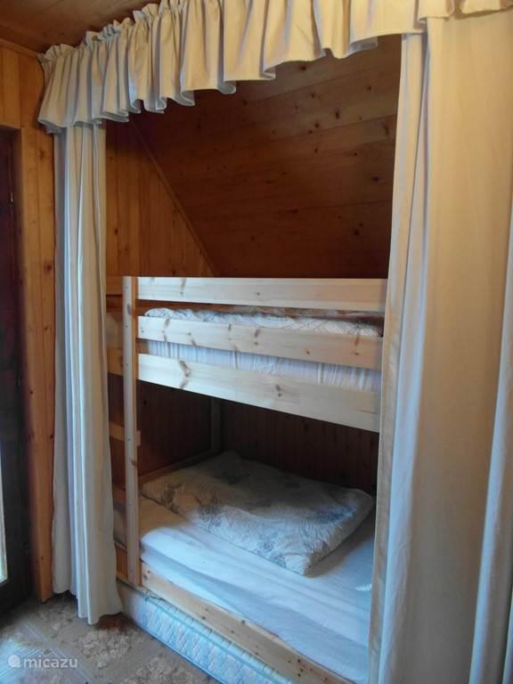 Slaapkamer 1 Stapelbedden links en rechts