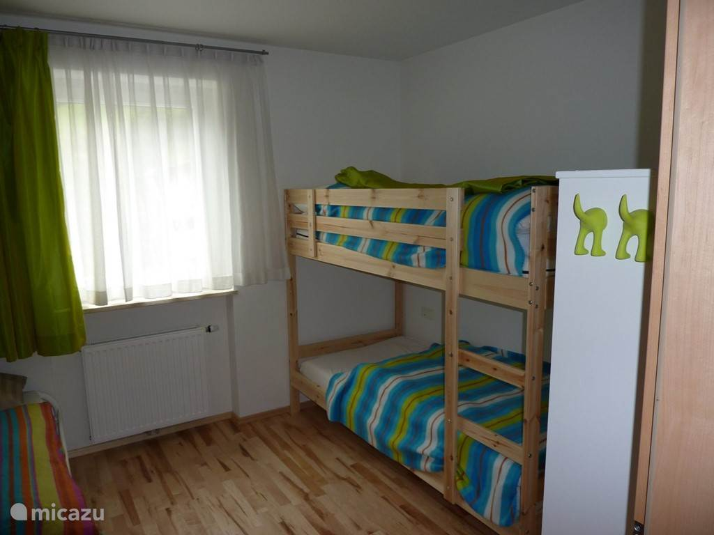 Bedroom with bunk bed and trundle.