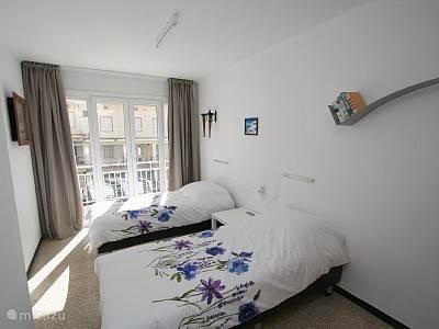 De slaapkamer 3 naast de douche.
