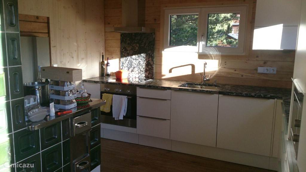 The new kitchen almost furnished, wood stove is maintained. Ideal for slow-cooking on your own fire
