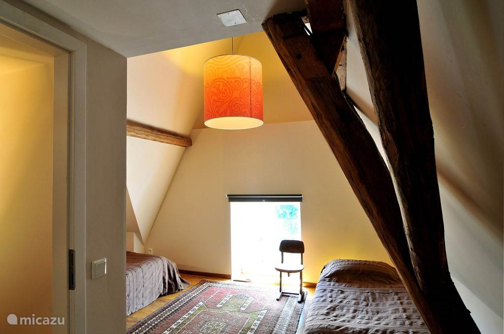 This bedroom has two single beds that can be put together if necessary. Above the door is a small 'play attic.
