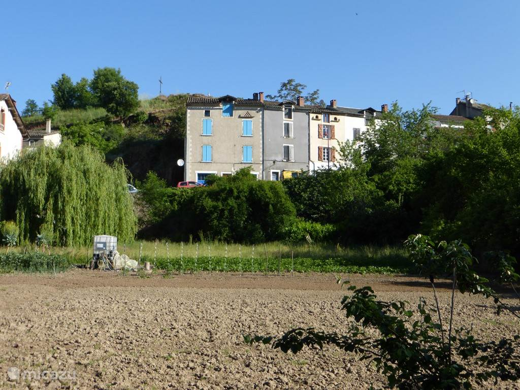 Our house from the river Viaur. It's the house right from the center with brown shutters