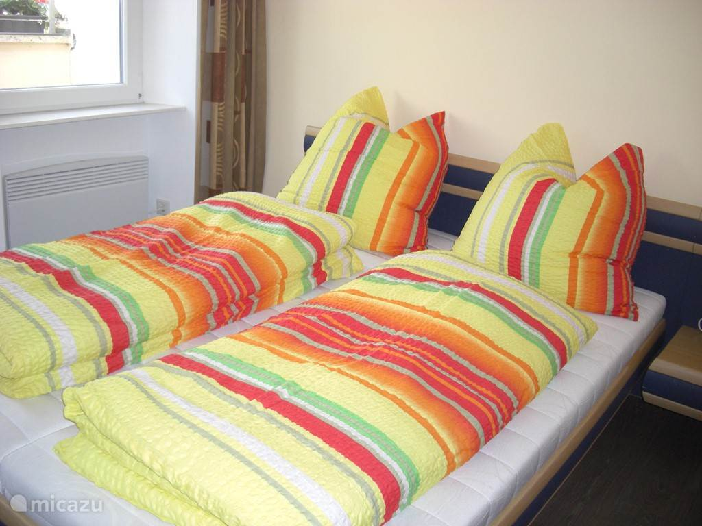 Bedroom with a double bed on the 2nd floor. From this room, the spacious terrace is accessible.