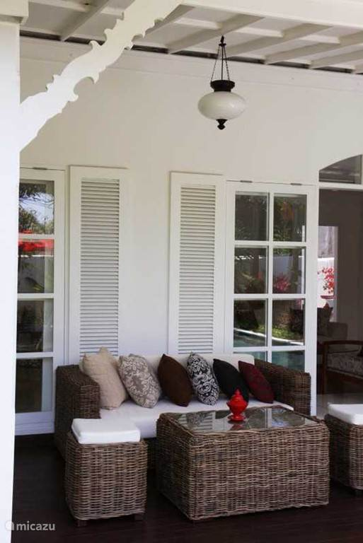 The veranda with its colonial style. We have installed two large ceiling fans; for a fresh breeze on hot days.