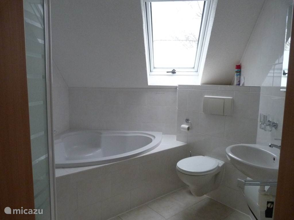 Upstairs bathroom with bath and shower