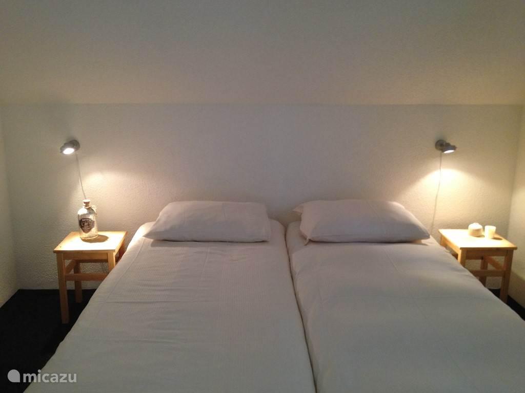 Slaapkamer inclusief hotellinnen.