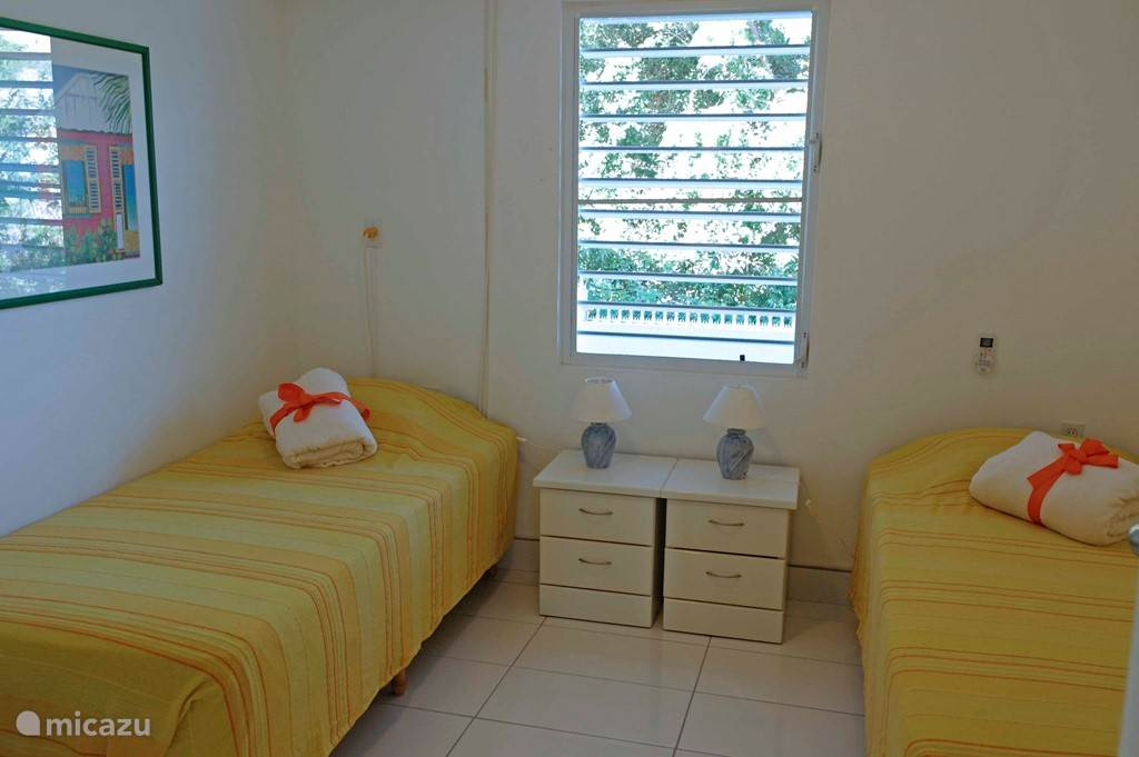 Double bedroom 2 with airconditioning and shared bathroom.