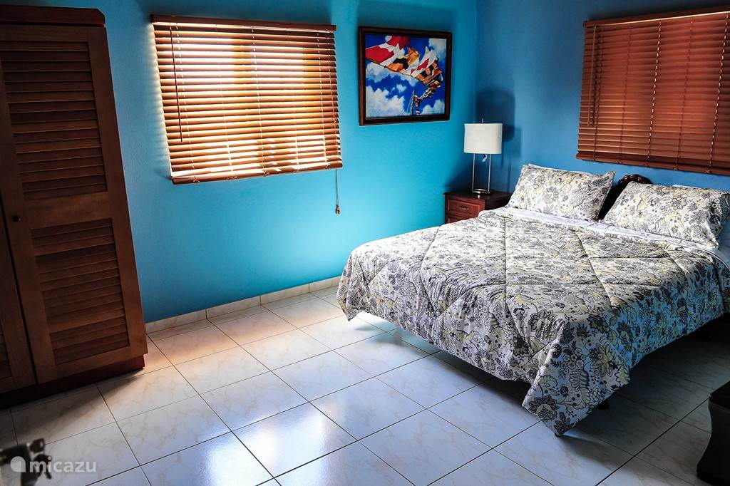 Master bedroom with large comfortable bed