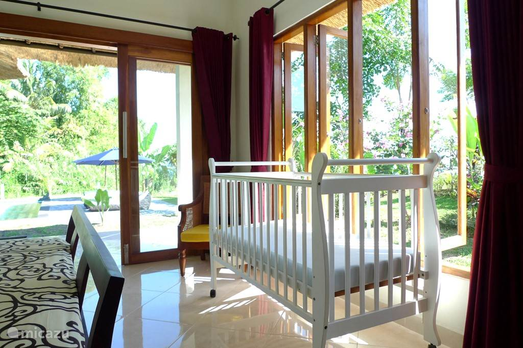 There are four bedrooms with en suite bathrooms one with bathtub. Three bedrooms have two single beds and one bedroom has two single beds. There is a cot and highchair available.