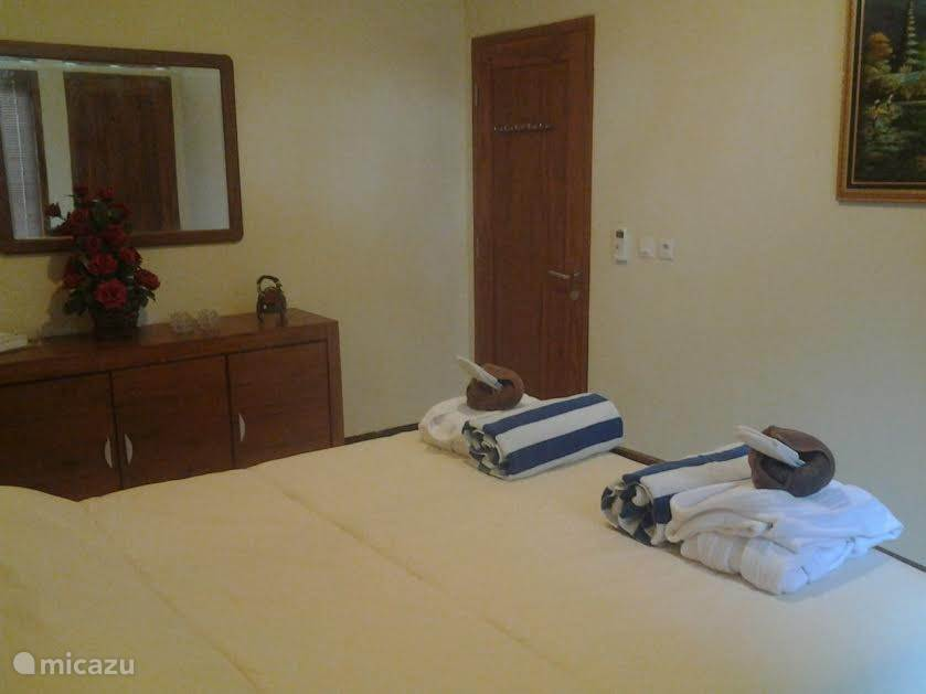 beautiful, spacious, clean bedroom with bath robe, beach towels and plenty of towels