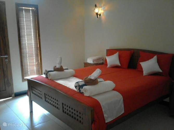 slaapkamer met aangrenzend een terras, 2 persoonsbed