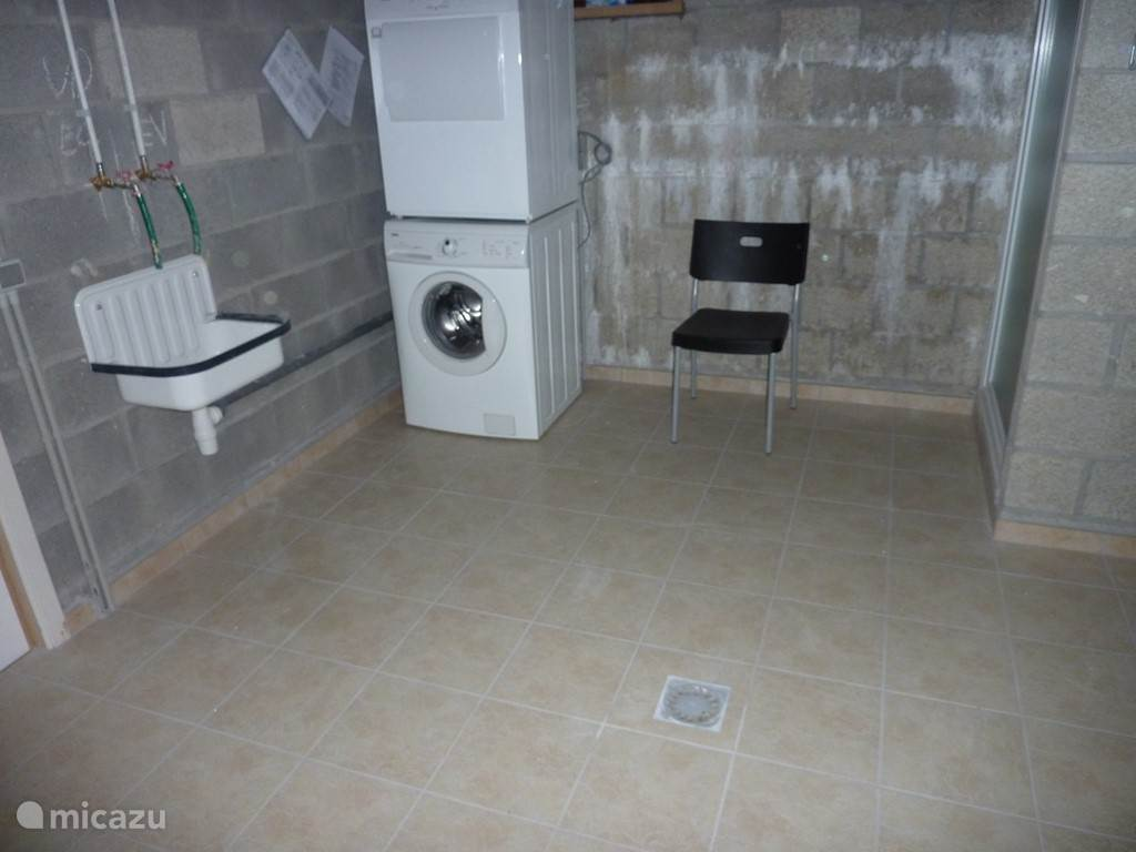In the basement, the laundry room with washer, dryer and a shower.