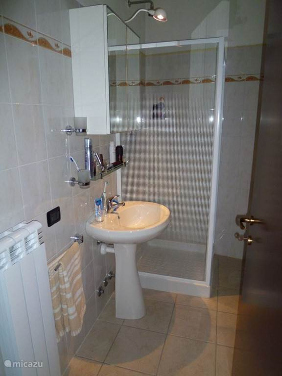 Bathroom with bidet and toilet.