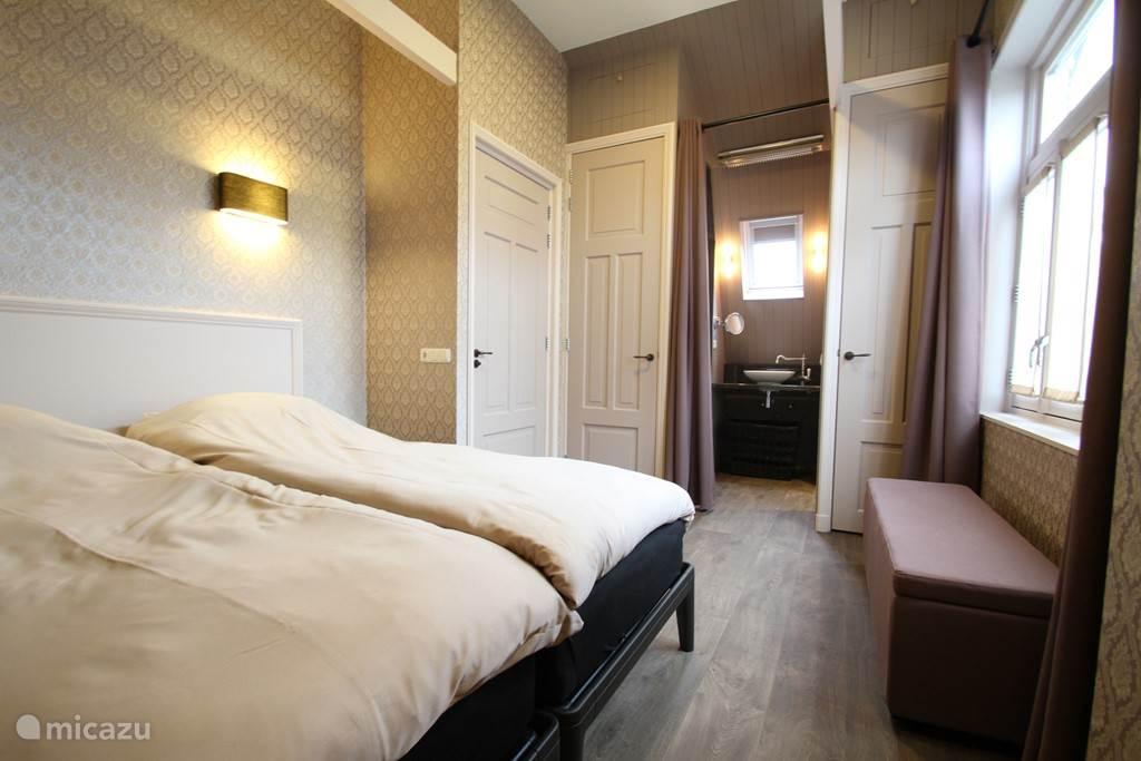 Slaapkamer met 2 eenpersoonsbedden