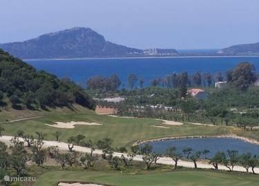 De bay 18 holes course, op 2 km van het huis
