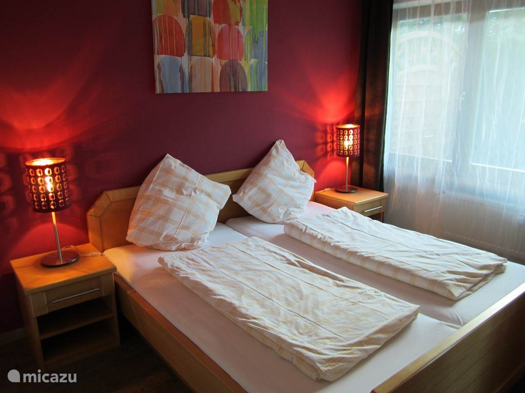 The large red double bedroom, with bed made of 180 wide by 200 cm. In addition to the linen closet in this room is also cot available.