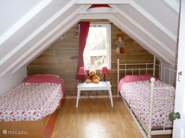 One bedroom with two single beds. A trundle bed is available for a fifth person.