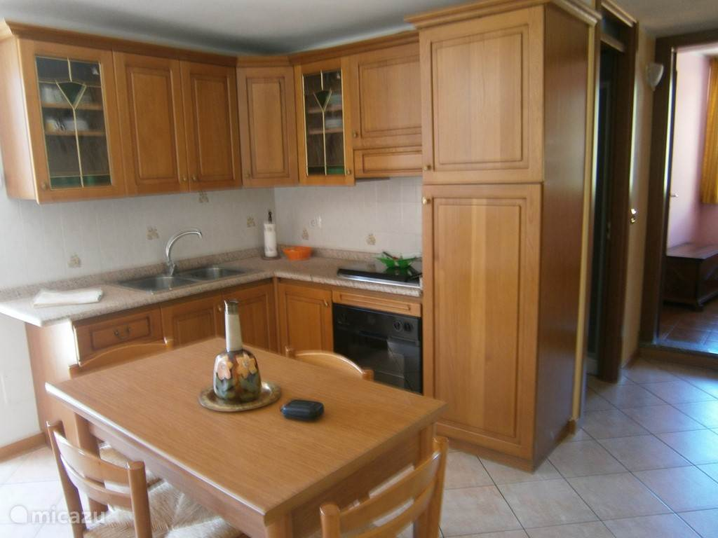 Oven, microwave, refrigerator, 4-burner stove and coffee maker.