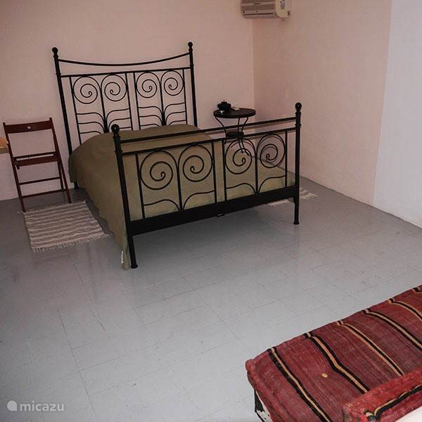 Een van de drie ruime slaapkamers, allen voorzien van 2 persoonsbedden