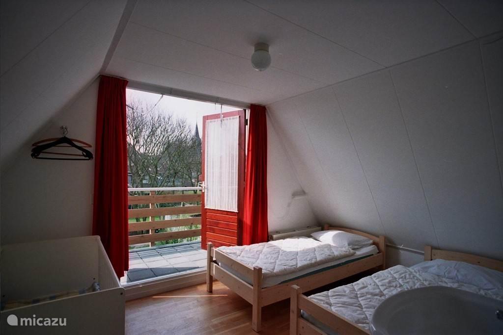 Grote slaapkamer tuinkant.