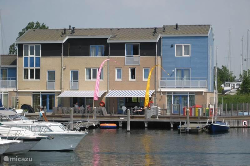 Vakantiehuis Nederland, Zeeland, Kortgene Vakantiehuis Havenhuis met eigen aanlegsteiger