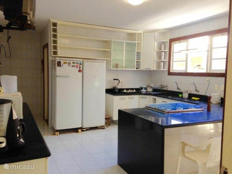 The kitchen is spacious, organized and within easy reach. Six burner stove with oven, microwave, electric coffee machine, etc.